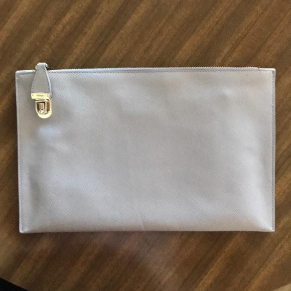 7e856bf0a4fa Prada saffiano lux clutch lavender - authentic! Prada.  M 5a5131d346aa7cf35401db78. M 5a5131da31a3768f6101d0d5.  M 5a51320836b9de458401da70